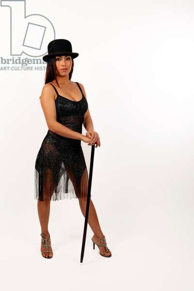 Oriental dancer in a 1920s flapper dress and a bowler hat - generic