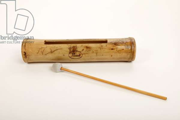 Large cut-out bamboo pitched sounding block with beater. (photo)