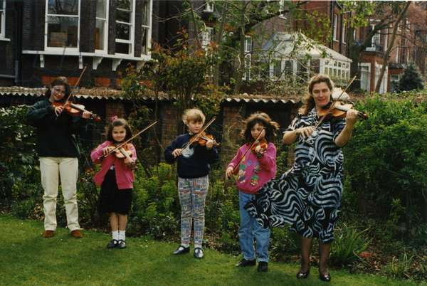 Violin teacher and her four young pupils
