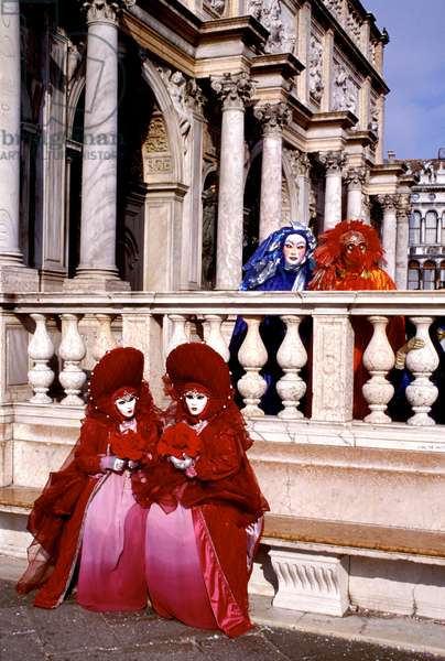 Two masked costumed women