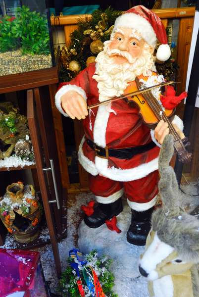 Father Christmas playing violin