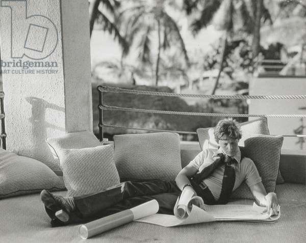 Amelia Earhart (1897-1937) looking at charts, 1936 (b/w photo)