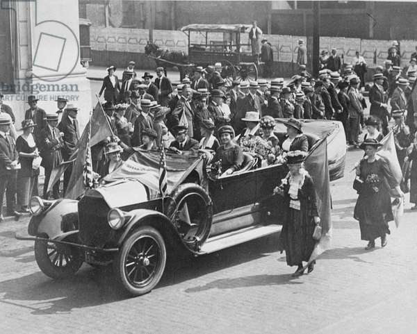 Carrie Chapman Catt (1859-1947) Upton and Shuler being driven in a suffrage parade, 1919 (b/w photo)