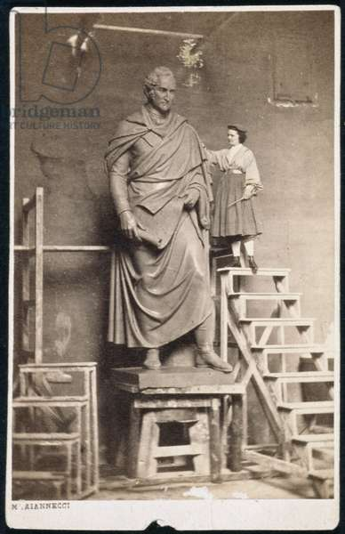 Harriet Hosmer (1830-1908) on ladder with her sculpture of Thomas Hart Benton (1782-1858), c.1860 (b/w photo)
