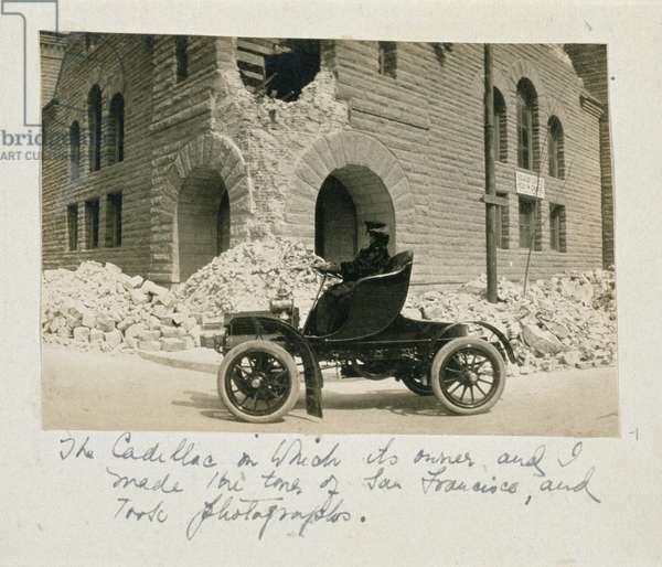 A woman touring the ruins after the San Francisco earthquake, 1906 (b/w photo)