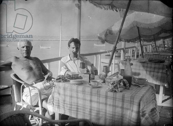 Pablo Picasso and Michel Sima, Golfe-Juan, c.1946 (b/w photo)