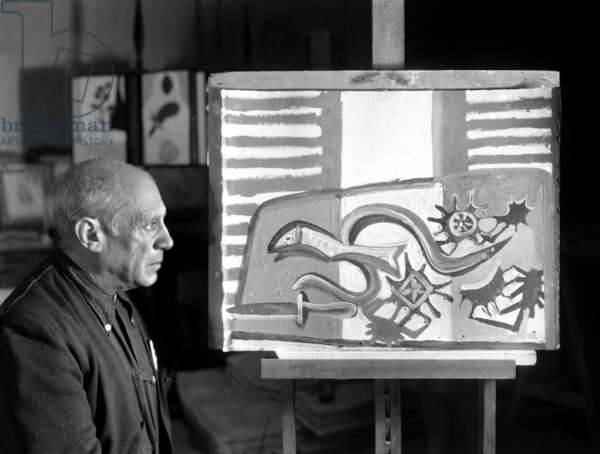 Pablo Picasso in his workshop in Antibes, 1946 (b/w photo)
