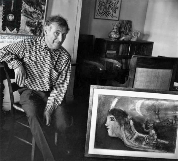 Marc Chagall and his daughter Ida's place in Paris (Ile de la cite) with the painting Le Traineau (1943), 1952 (b/w photo)