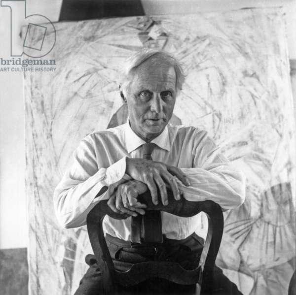 Max Ernst in his studio in Paris, 1952 (b/w photo)
