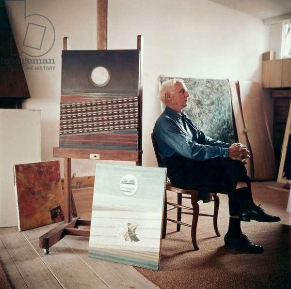 Max Ernst in his studio in Paris, c.1955 (photo)