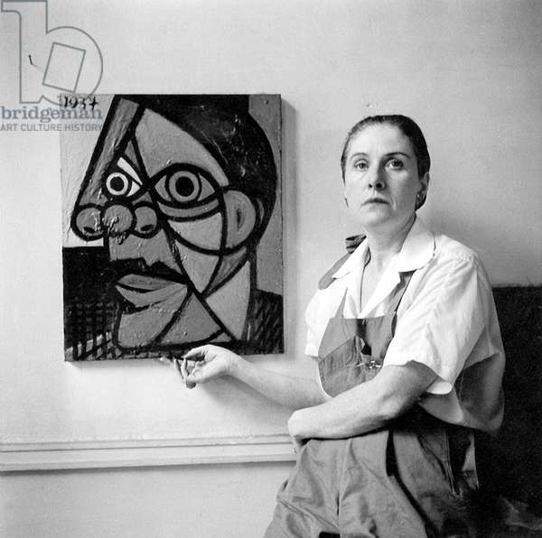 Dora Maar in front of her 1937 portrait by Pablo Picasso, c.1947 (b/w photo)