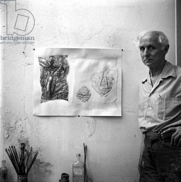 Max Ernst in his Paris studio, c.1955 (b/w photo)