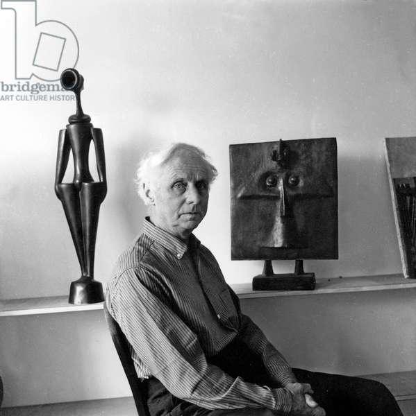 Max Ernst in his studio in Paris, c.1955 (b/w photo)