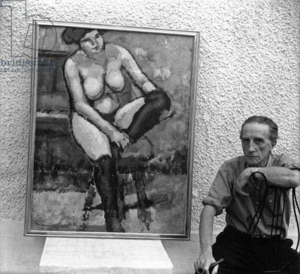 Marcel Duchamp posing near a canvas in his workshop, c.1957 (b/w photo)