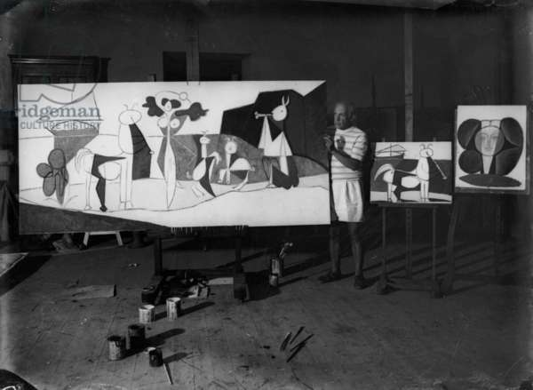 Pablo Picasso in his workshop in Antibes with his canvas, 'La joie de Vivre', Summer 1946 (b/w photo)