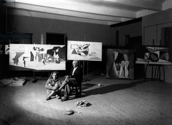 Pablo Picasso in his workshop in Antibes with his companion Francoise Gilot, Summer 1946 (b/w photo)