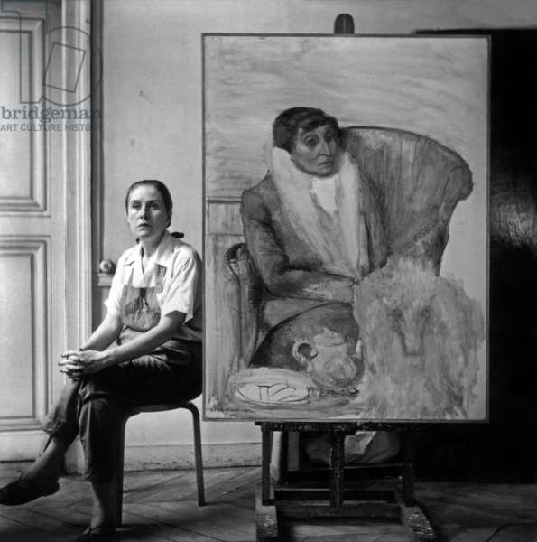Dora Maar seated by a painting of Alice B. Toklas, c.1947 (b/w photo)