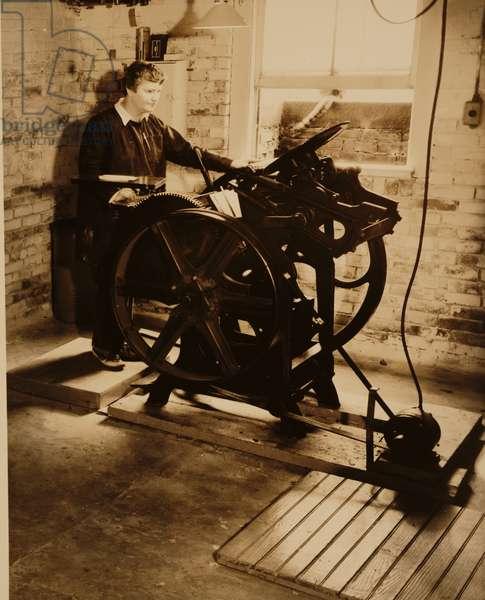Elizabeth McCausland at her printing press, c.1935 (b/w photo)