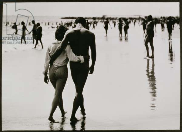 Couple Walking in the Water at Coney Island, New York City, Untitled 46, c.1953-64 (b/w photo)