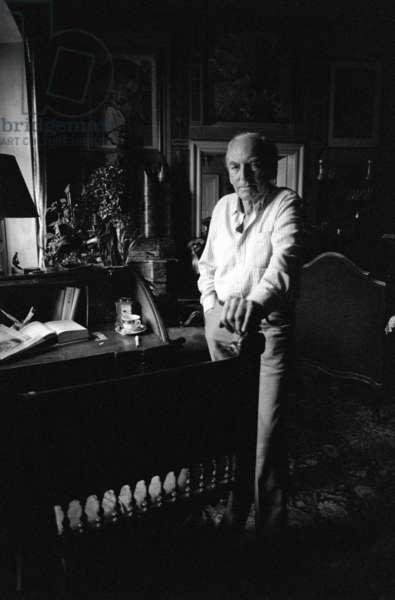 Jiri Mucha standing by his desk in his house in Hradcany, Prague (b/w photo)