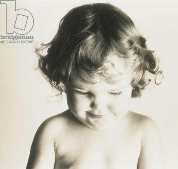 Girl (9-12 months) posing in studio