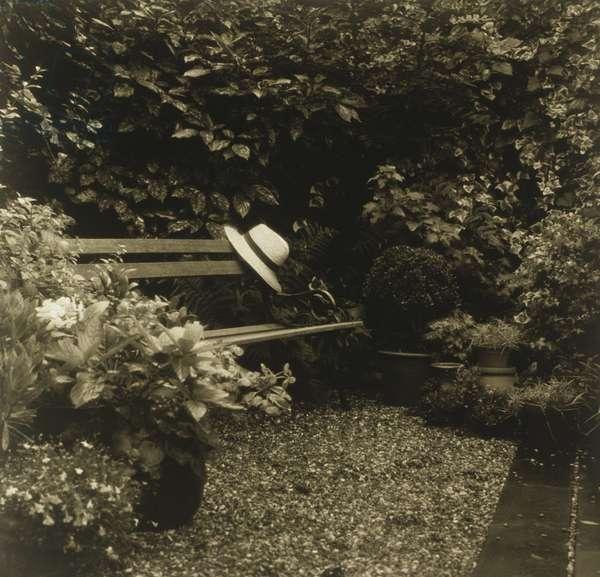 Hat hanging on garden bench