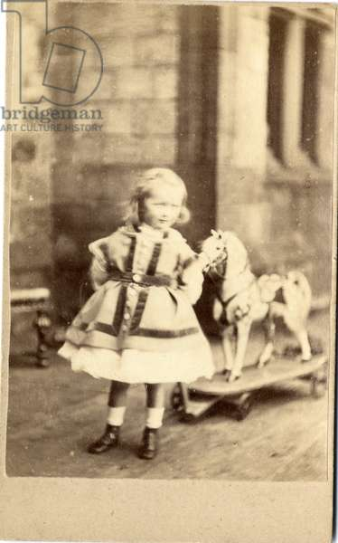 Young girl with her pull-along toy horse, 1860s (albumen print)