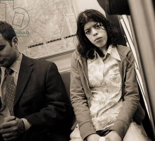Woman sitting on a subway and staring, 2004 (b/w photo)