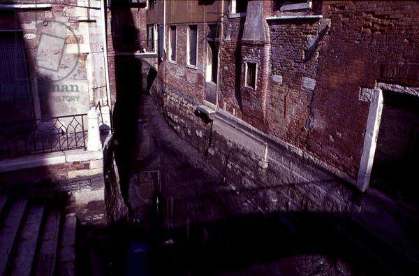 A canal drained prior to dredging, Venice, Italy (photo)