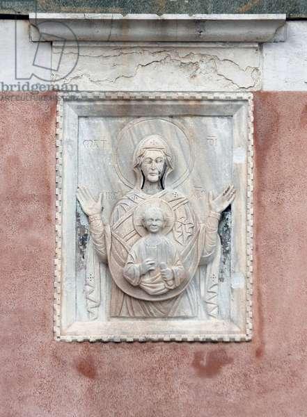 Relief of the Madonna and Child on the facade of the deconsecrated church of Santa Maria Valverde (Santa Maria della Misericordia), Cannaregio, Venice (photo)
