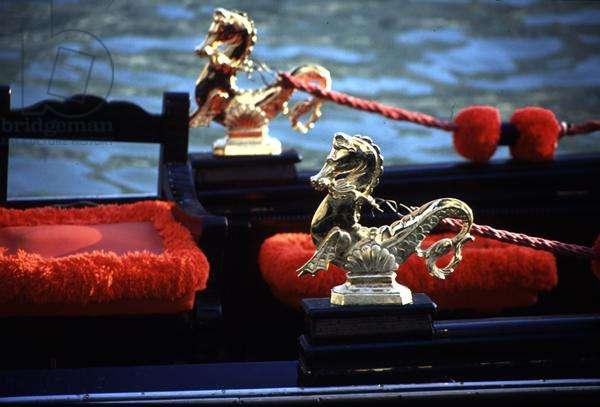 Brass horses decorating a gondola (photo)
