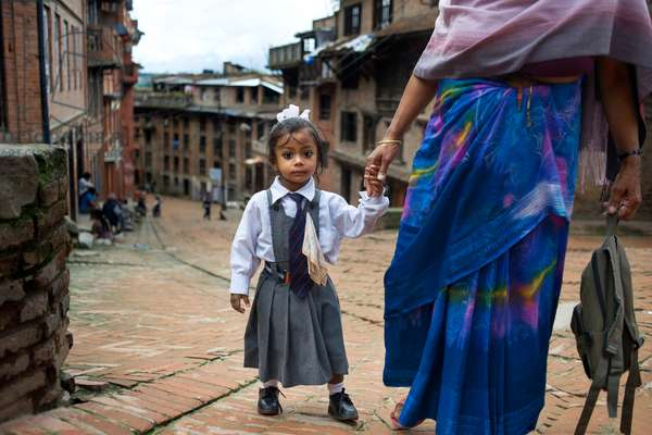 A mother taking her daughter to school, Bhaktapur, Kathmandu Valley, Nepal (photo)