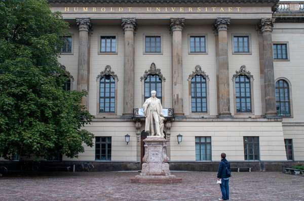Humboldt University. Facade and statue of the German physicist Hermann von Helmholtz (1821-1894). Berlin, Germany (photo)