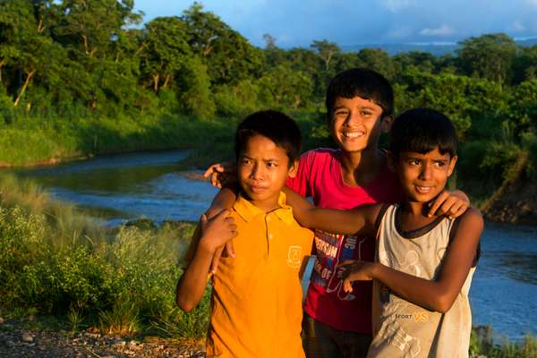 Friend boys in Rapti River, Chitwan National Park, Nepal, Asia (photo)