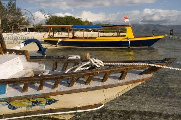 Scenic Landscape, Sunset at Gili Meno Island, Lombok, Indonesia,  Some fishing boats rest in the sand of the beach of the West zone of the island, the most uninhabited one touristically speaking, Gili Meno, 2018 (photo)