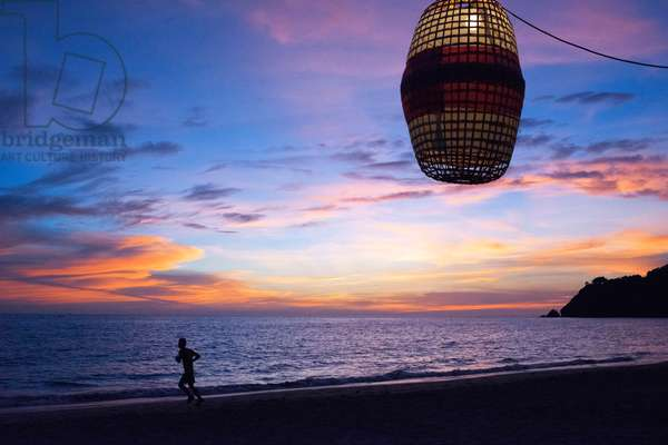 Paper lights and sunset in the beach, Andaman Island, Thailand (photo)