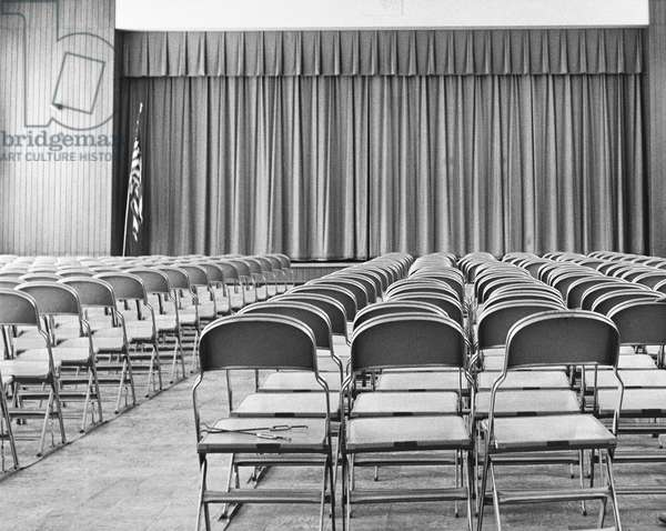 Empty chairs in a stage theater