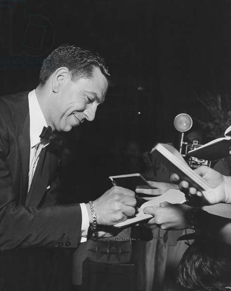 Actor Jack Webb signing autographs