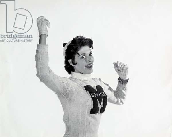 Female cheerleader cheering
