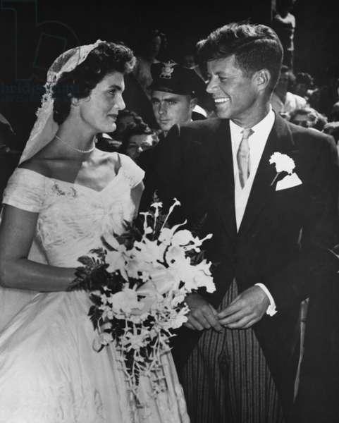 Senator John F. Kennedy (1917-63) and Jacqueline Bouvier (1929-94) at their wedding, 12th September 1953 (b/w photo)