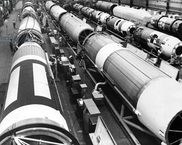High angle view of engineers working in a missile factory, Titan ICBM, Denver, Colorado, USA