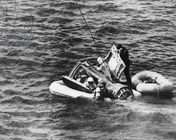 Rescue squad taking out two astronauts from a space capsule in the sea, Gemini VI