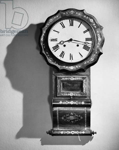 Close-up of clock hanging on wall