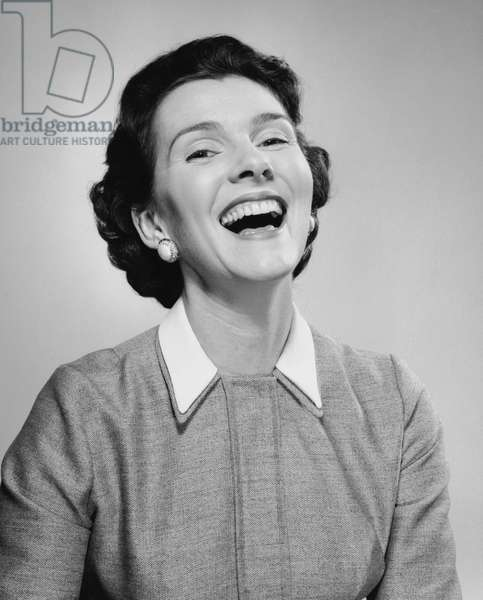 Close-up of a mid adult woman laughing