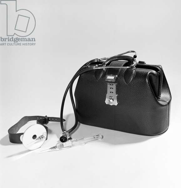 Close-up of medical equipment near doctor's bag, 1950s