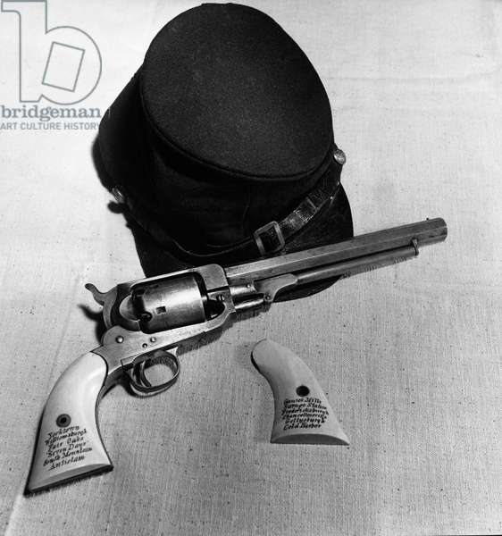 Close-up of a revolver with a hat