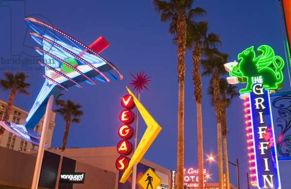 Neon signs lit up at night in a city, Fremont Street East District, Las Vegas, Nevada, USA (photo)