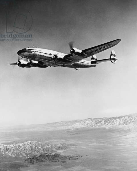 Low angle view of an airplane in flight, Pan American World Airways
