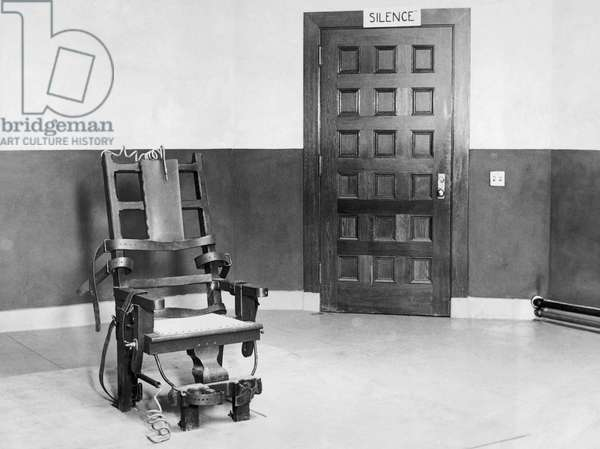 Electric chair in an empty room