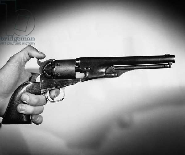 Close-up of a man's hand holding a revolver